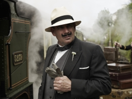 "Hercule Poirot standing by a steam train at Churston Station which featured in Agatha Christie's ""The ABC Murders"""